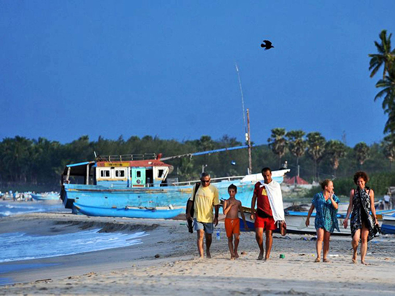 Shore thing: tourists on the beach in Trincomalee